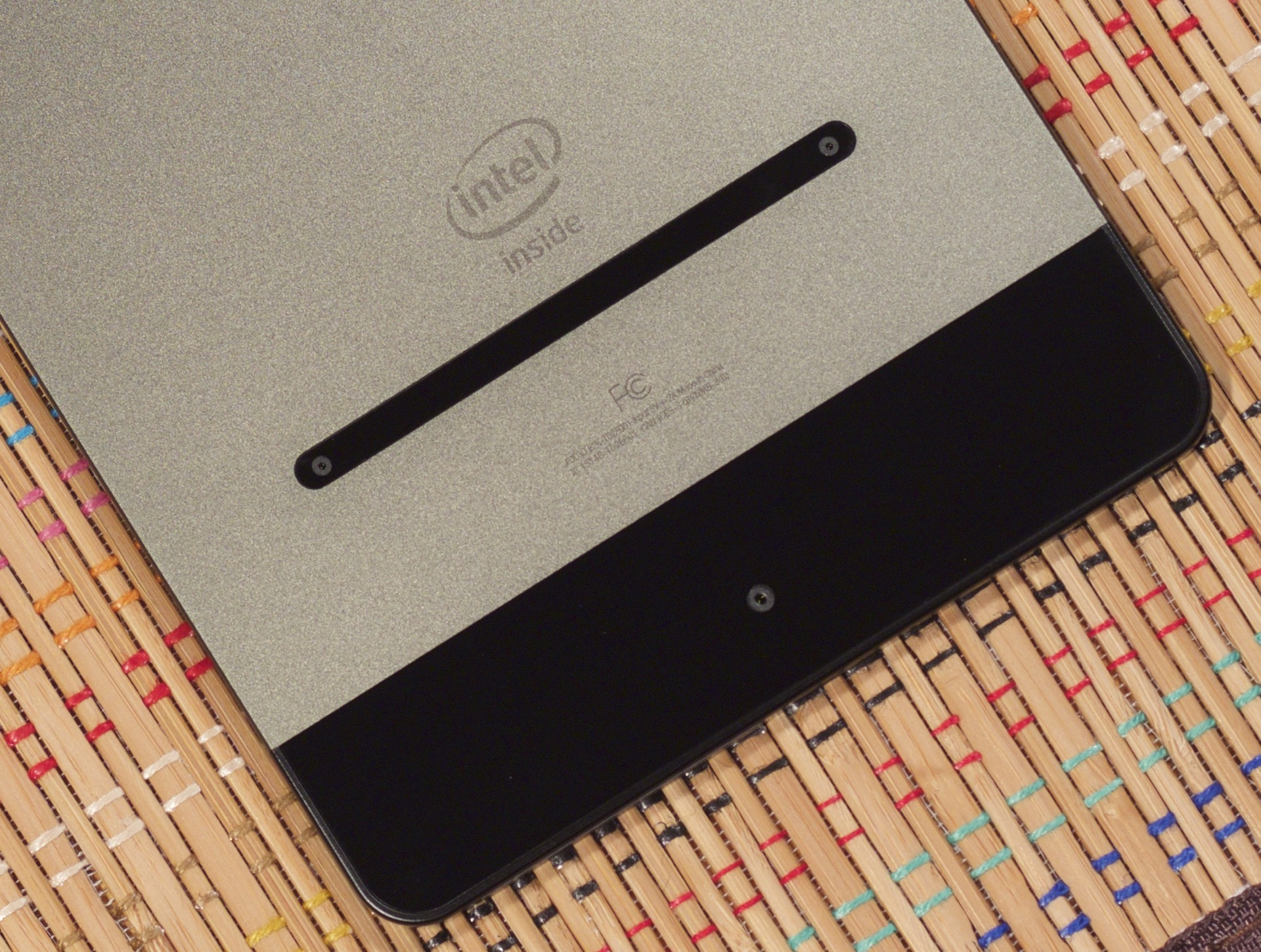 The main camera is centered on the bottom. The RealSense cameras are in the little black strip below the Intel logo.