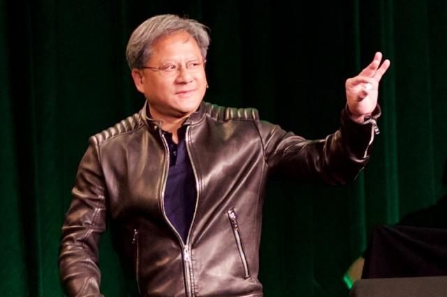 Nvidia CEO Jen-Hsun Huang holding a new Tegra X1 SoC.