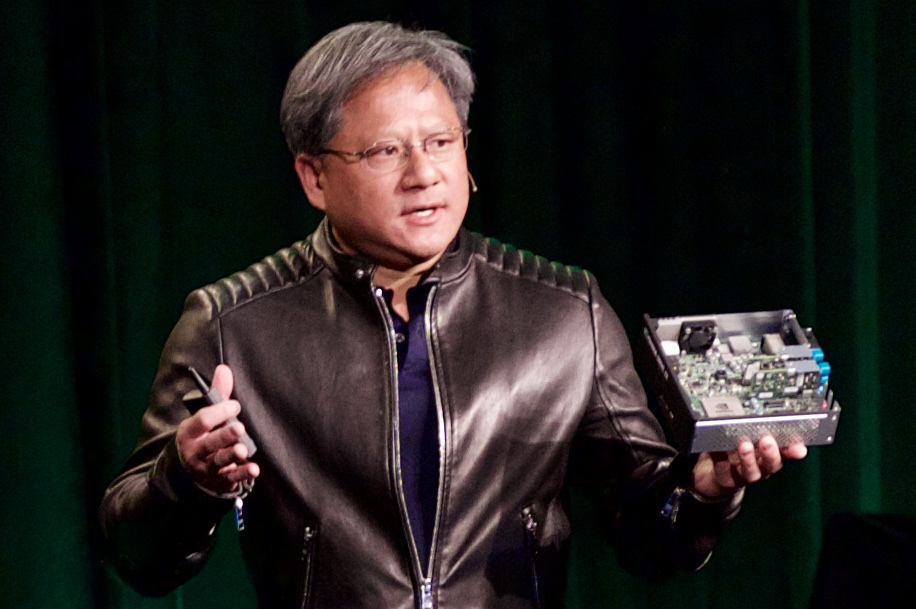 Jen-Hsun Huang with the Nvidia Drive CX.