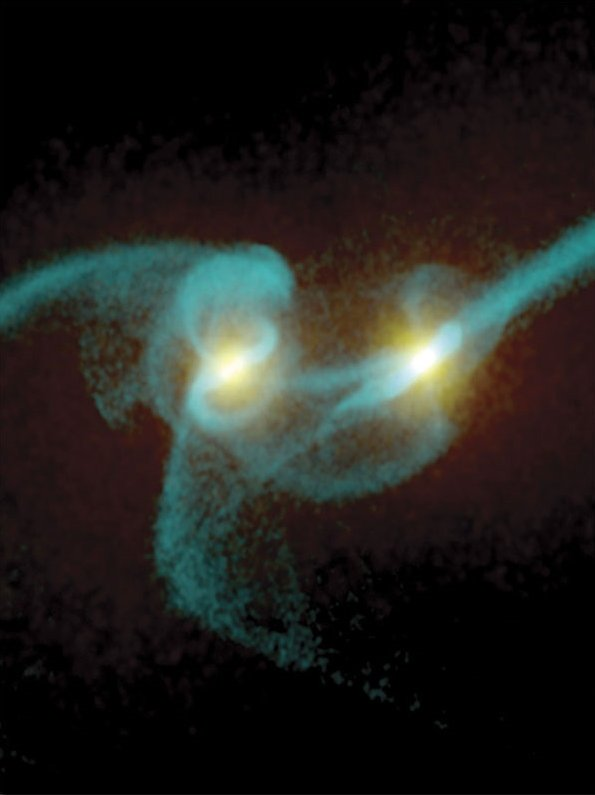 Two supermassive black holes, significantly farther apart (about 3000 light-years) than the two discussed in this article (about one-third of a light-year apart).
