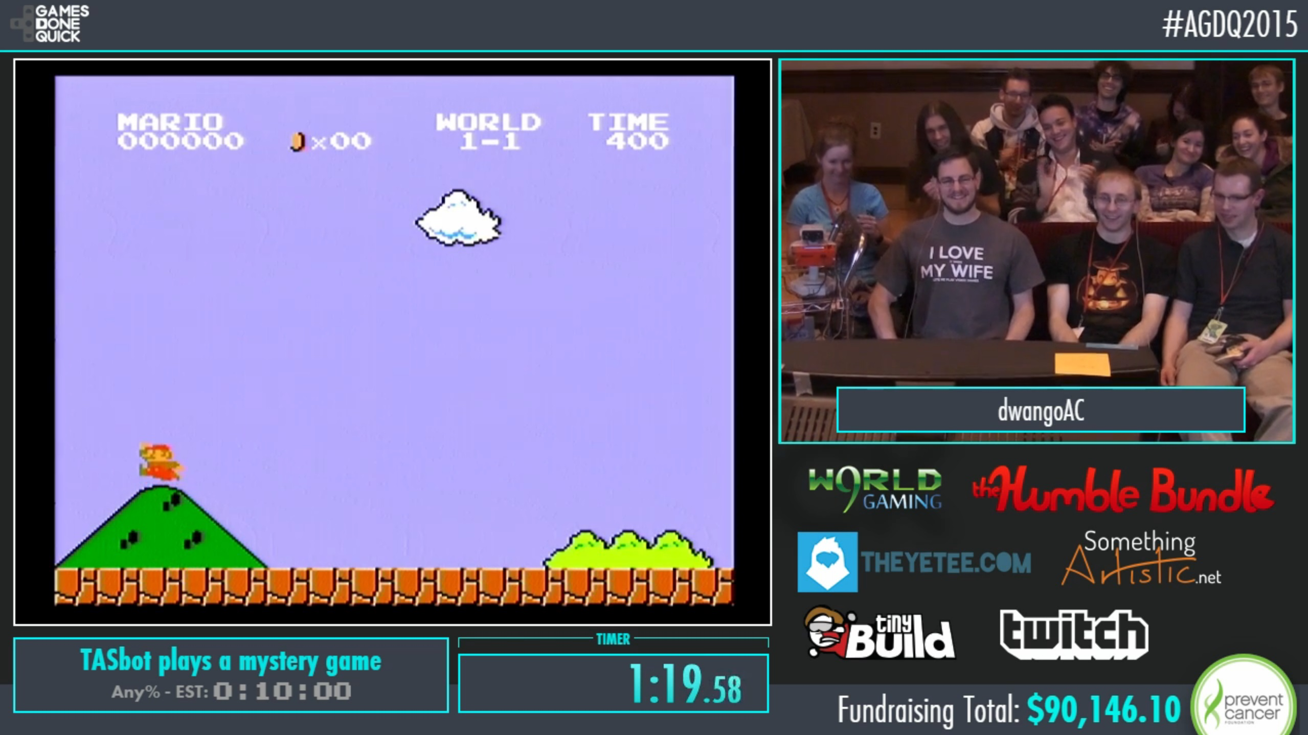 Members of the TASBot team smile as <i>Super Mario Bros.</i> runs through <i>Super Mario World</i> during AGDQ Sunday night.