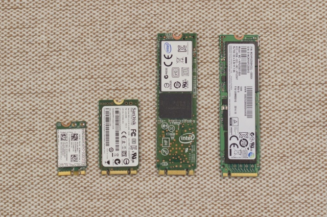 Four M.2 cards, from left to right: An A- and E-keyed Wi-Fi card, two B- and M-keyed SSDs, and an M-keyed SSD.