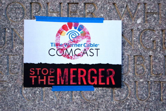 A sign at an October rally against the merger in New York City.
