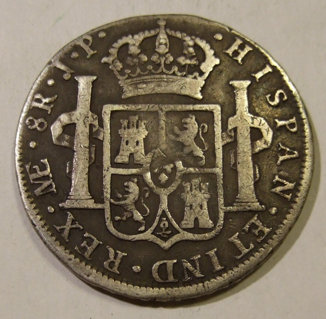 A Spanish silver piece of eight minted in Peru in 1811.