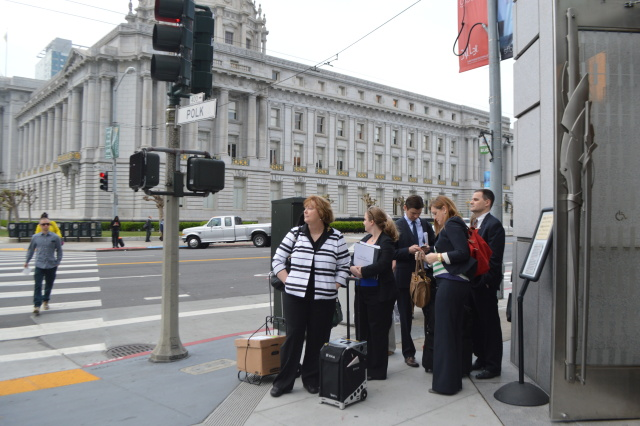 Kleiner Perkins' lawyers led by Lynne Hermle (center) standing outside the San Francisco Superior Court in March before closing arguments in the <em>Ellen Pao Vs. Kleiner Perkins</em> case.