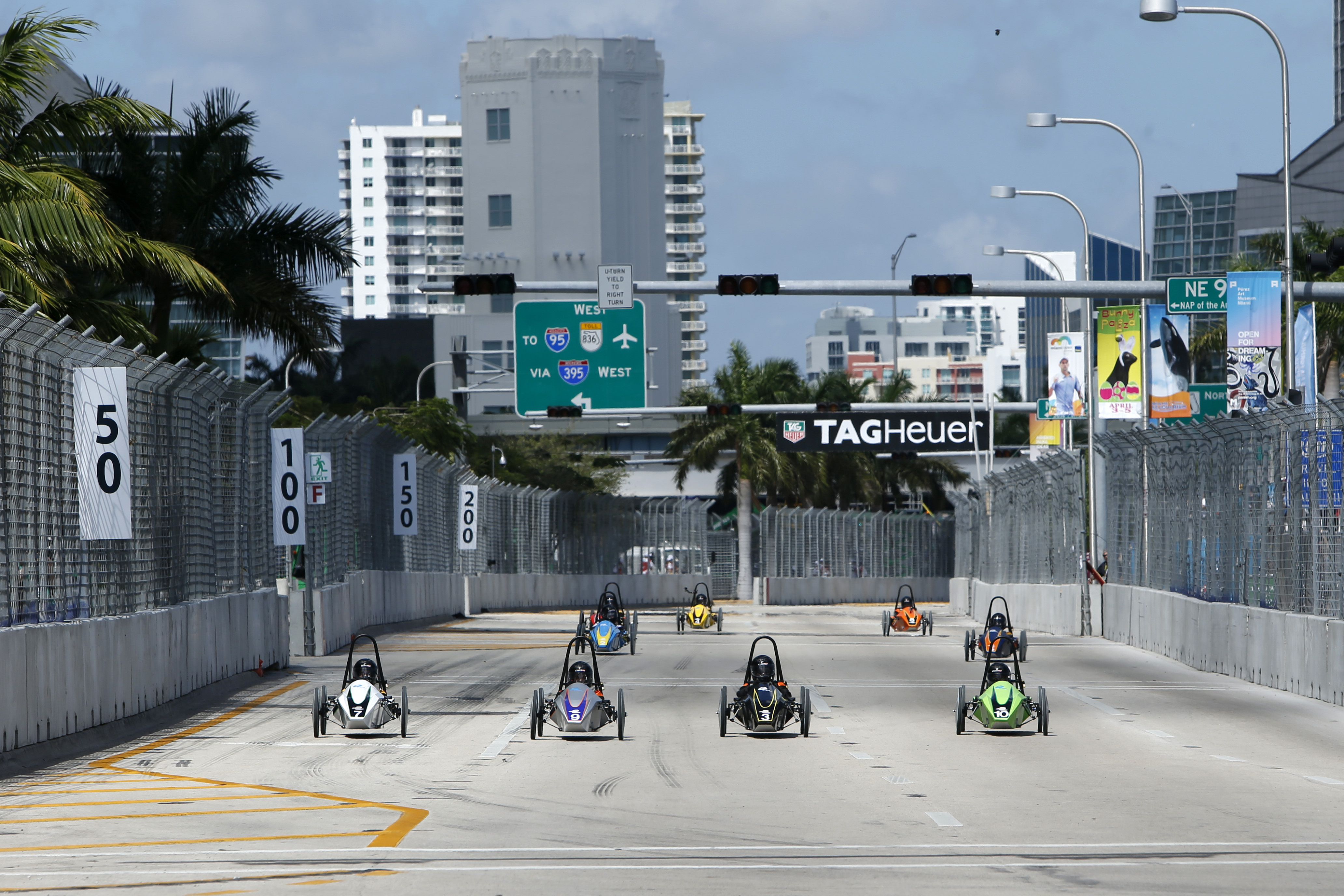 The Formula E Schools racers go four-wide down one the straights. Even though speeds were a fraction of the full size cars it was still gripping.