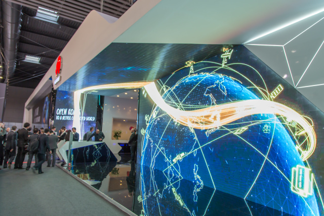 At MWC 2015, the entrance had a massive LED screen that wrapped up the wall, across the ceiling, and down the other wall.