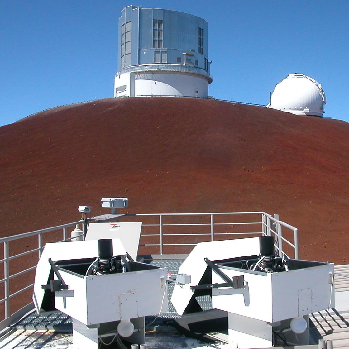 These tiny HATNet telescopes (foreground) can spot exoplanets more readily than their big brethren.