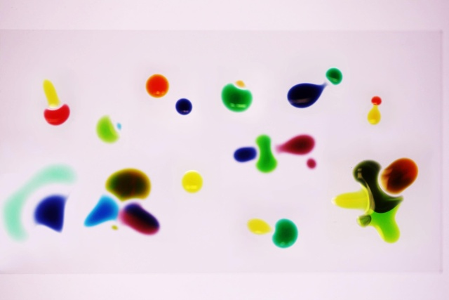 Liquid droplets that chase each other across a surface