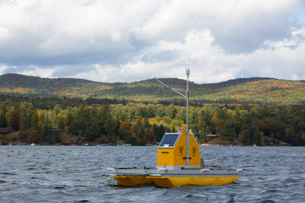 A floating platform housing sensors that log measurements beneath the surface of Lake George.