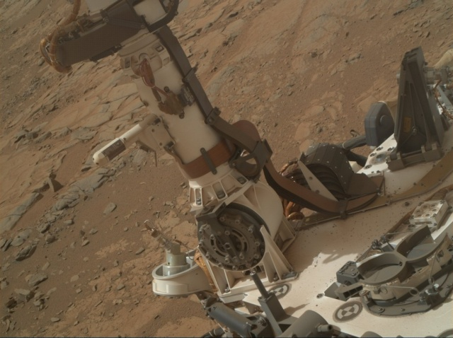 The instruments on Curiosity that help measure the local weather conditions. In the background?  Mars.