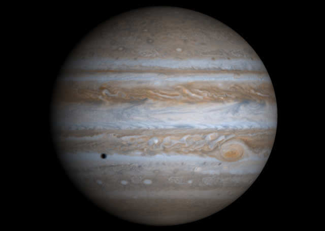 True-color composite image of Jupiter. The black dot is the shadow of Europa, one of Jupiter's moons.