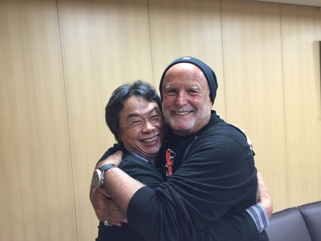 Sony film producer Avi Arad embraces Super Mario series creator Shigeru Miyamoto in an image that was part of the giant Sony Pictures e-mail leak.