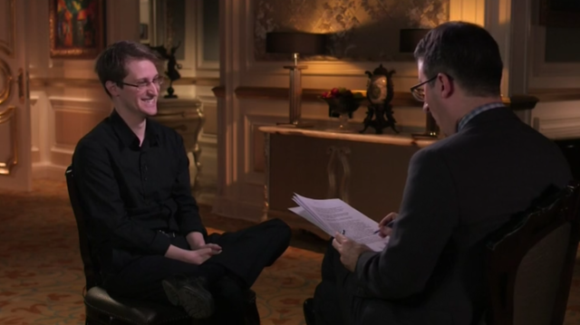 Edward Snowden and John Oliver share a laugh.