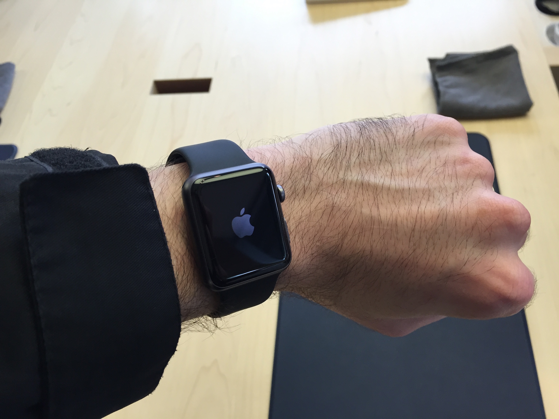 Trying on the space gray Apple Watch Sport in-store.