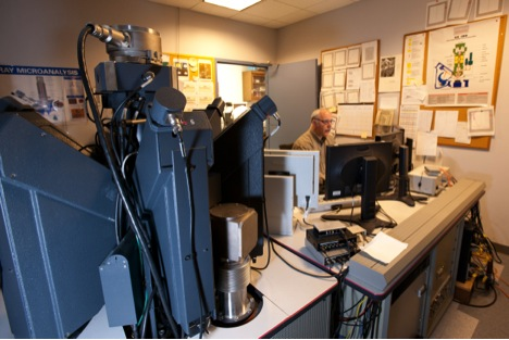 Denton Ebel uses the electron microprobe in the AMNH's Microscopy and Imaging Facility to map the concentrations of chemical elements in each pixel of the surface being studied.