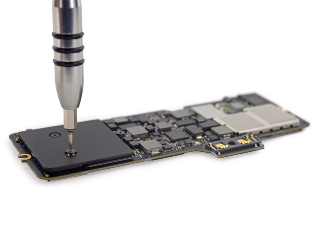 iFixit has torn apart the new MacBook—this is the logic board in its entirety.
