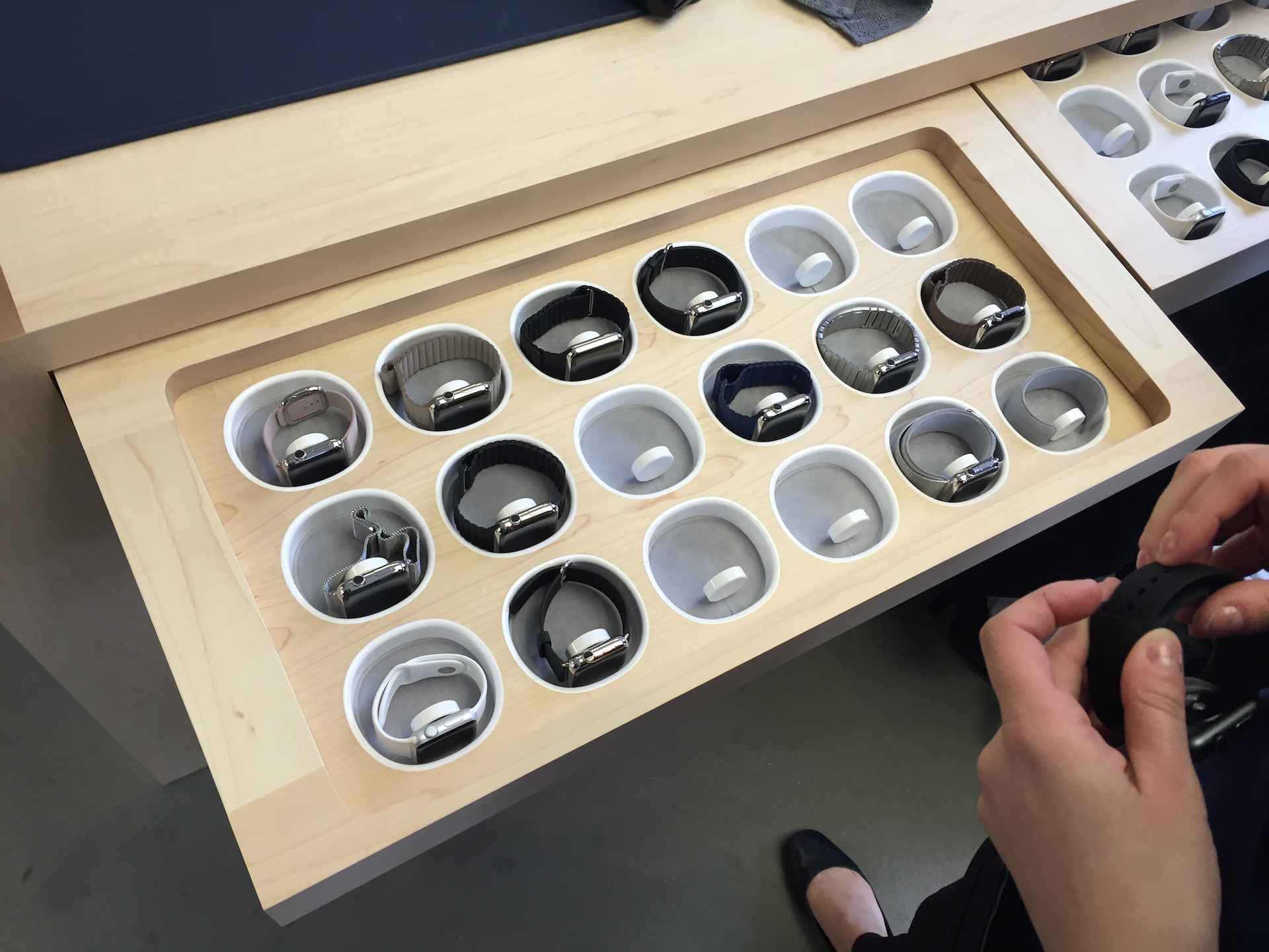 Apple Watches are all kept in a tray that employees unlock with their iPhone point-of-sale systems.