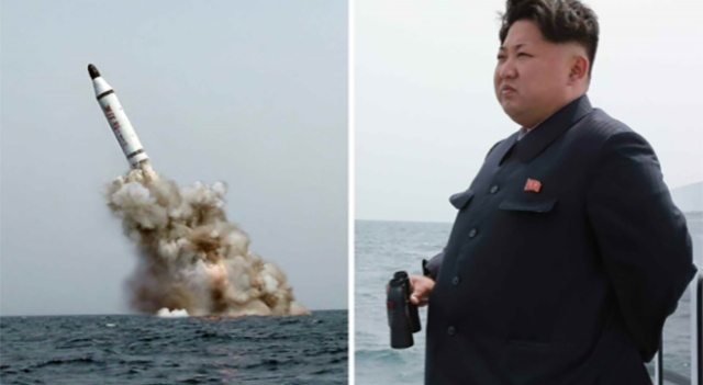 Kim Jong-un watches as North Korea's navy successfully test-launches a ballistic missile from a submarine on May 9.