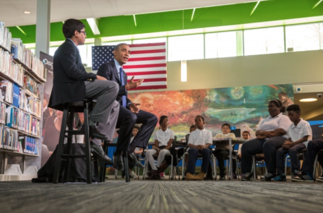 President Barack Obama speaks to students at the Anacostia Neighborhood Library in Washington, DC.