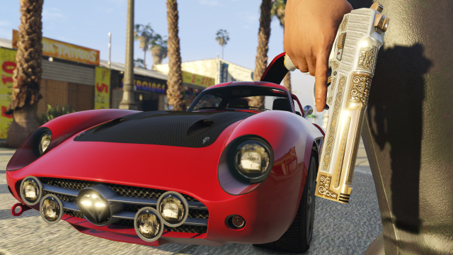 If you want to increase the field-of-view of this image of a gun and a car in <em>Grand Theft Auto V</em> on PC, Rockstar Games won't stop you.