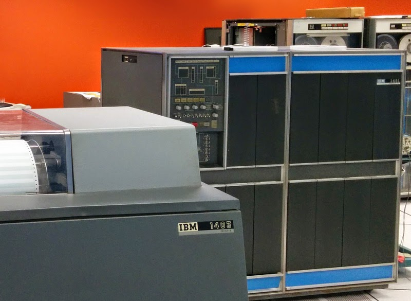 """Line printer and IBM 1401 mainframe at the Computer History Museum. This is the computer I used to run my program. The console is in the upper left. Each of the dark rectangular panels on the computer is a """"gate"""" that can be folded out for maintenance."""