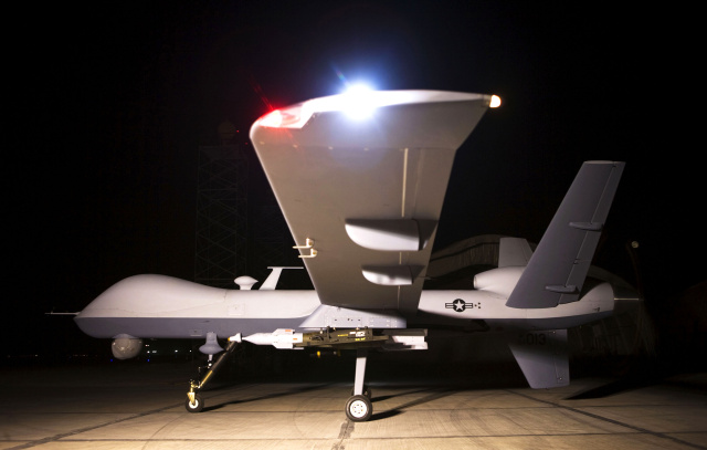 An MQ-9 Reaper sits on a ramp in Afghanistan September 31. The Reaper is launched, recovered, and maintained at deployed locations, while being remotely operated by pilots and sensor operators at Creech Air Force Base, Nevada.  (Courtesy photo)