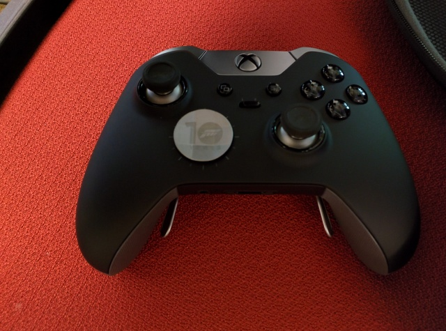 What a pro. Here, the new, all-silver controller has been equipped with a dial-style d-pad. I didn't much care for that option, but I liked most everything else about the new controller.