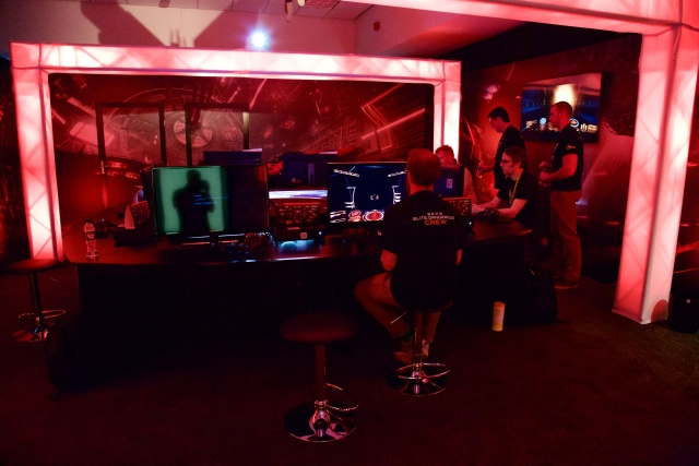 Long shot of the demo area, with lots of consoles set up.