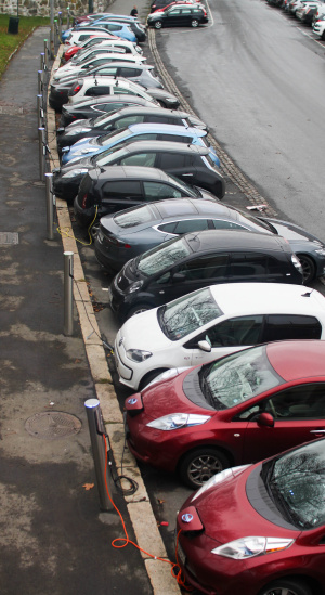 A row of EVs taking advantage of free public charging in Oslo, Norway.