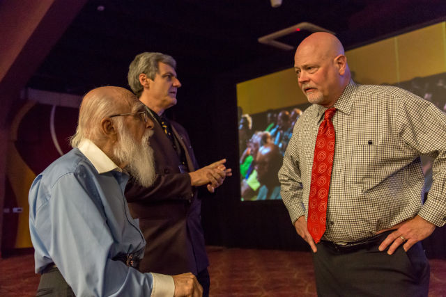Statistician Chip Denman (at right) talks to James Randi (left) before the test. Million Dollar Challenge test director Richard Saunders is at center looking right.