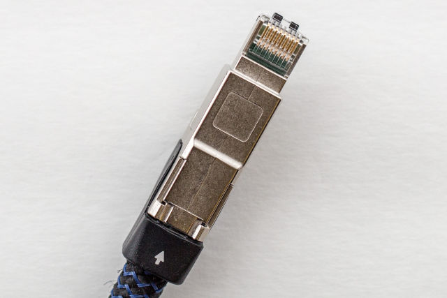 "Close-up of the AudioQuest Vodka Ethernet cable. Note the arrow on the connector. ""All audio cables are directional,"" <a href="