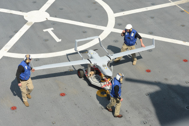 "The RQ-21A Small Tactical Unmanned Air System (STUAS), branded by Insitu as the ""Integrator"", being tested aboard USS Mesa Verde (LPD 19). Insitu approached Hacking Team about putting Wi-Fi hacking hardware aboard drones."