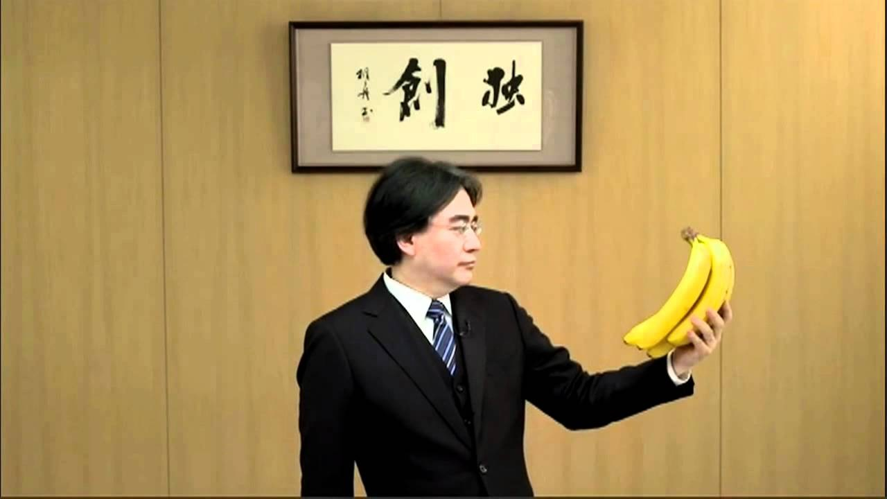 Iwata stares as some bananas during a Nintendo Direct presentation.