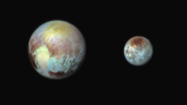 A false color image of Pluto and Charon, showing lots of regional differences in surface composition.