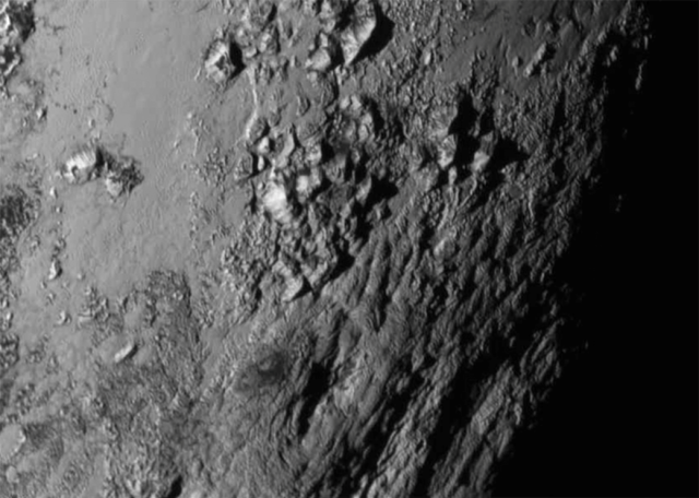 Pluto's Icy mountains and a surprising lack of impact craters nearby.