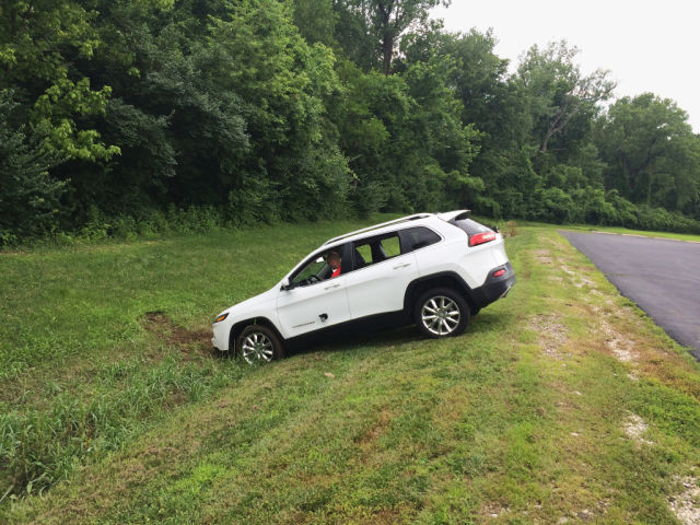 Security researcher Charlie Miller attempts to extract a Jeep Cherokee from a ditch after its brakes were remotely disabled in a controlled test.
