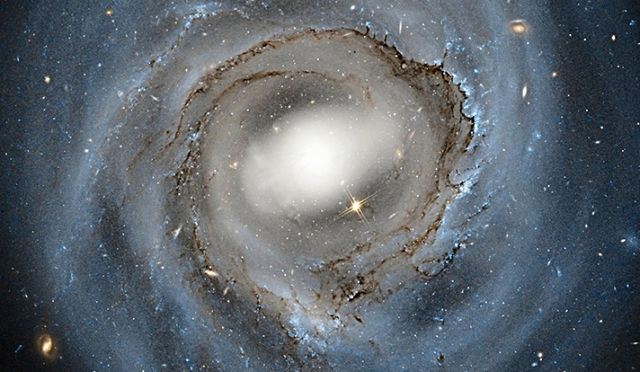 Verlinde makes some assumptions we know don't apply, like spherical symmetry—spiral galaxies are disks, not spheres.