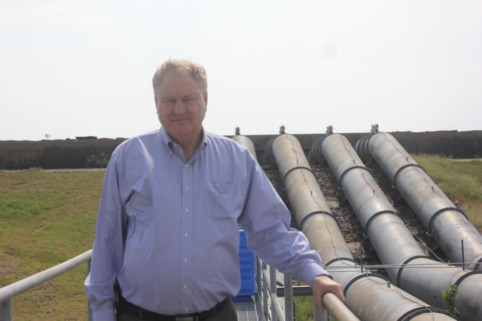 Malcolm Wood, these days the deputy chief operating officer on site, stands in front of pumps and the levee at the southern end of the Michoud Assembly Facility in July 2015.