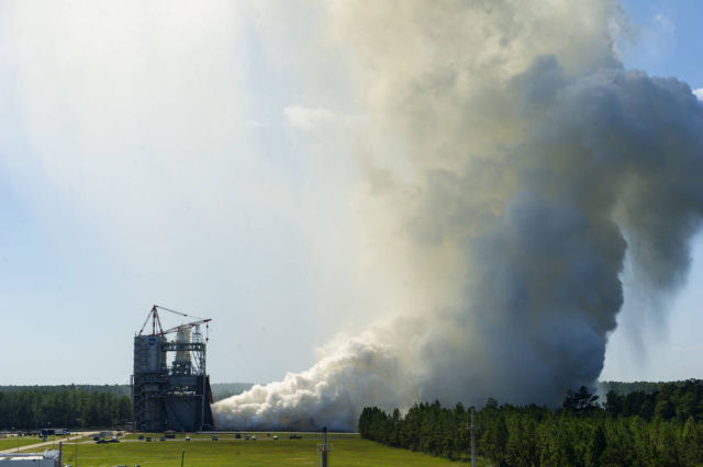 """The RS-25 engine fires up for a 535-second test August 27, 2015 at NASA's Stennis Space Center near Bay St. Louis, Mississippi. This is the final in a series of seven tests for the development engine, which will provide NASA engineers critical data on the engine controller unit and inlet pressure conditions,"" NASA writes."