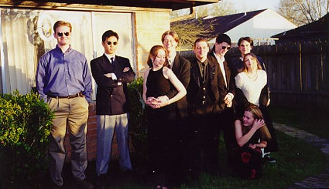 The local Babbage's crew (or most of them, anyway) circa 1997, when Windows 95 was in full effect. Also in full effect: <em>Mall Rats</em>-style haircuts. Author's one-day wife and author himself are third and fourth from left, respectively.