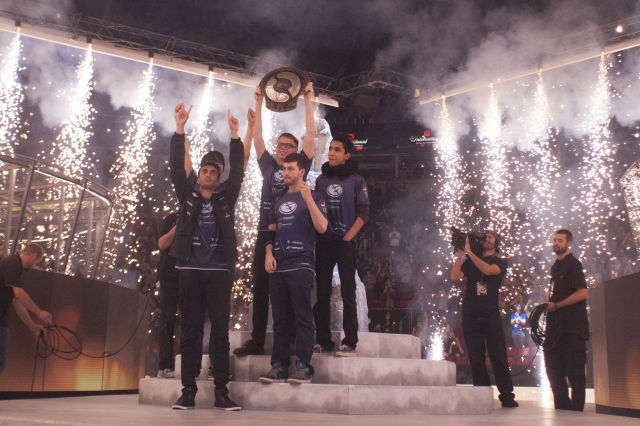 <em>Dota 2</em> team Evil Geniuses, seen here enjoying a pyrotechnics-loaded victory moment after winning The International 5 in Seattle.