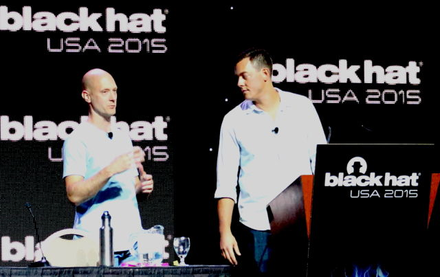 Charlie Miller (left) and Chris Valasek present the details of their hacks of the Fiat Chrysler Uconnect system at Black Hat in Las Vegas on August 5.