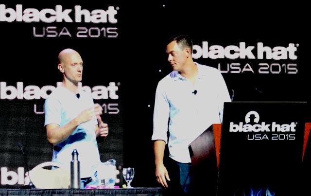 Charlie Miller (left) and Chris Valasek present the details of their hacks of the Fiat Chrysler Uconnect system at Black Hat in Las Vegas on August 5.