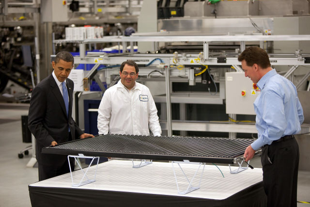 President Obama and the Solyndra CEO view one of its products.
