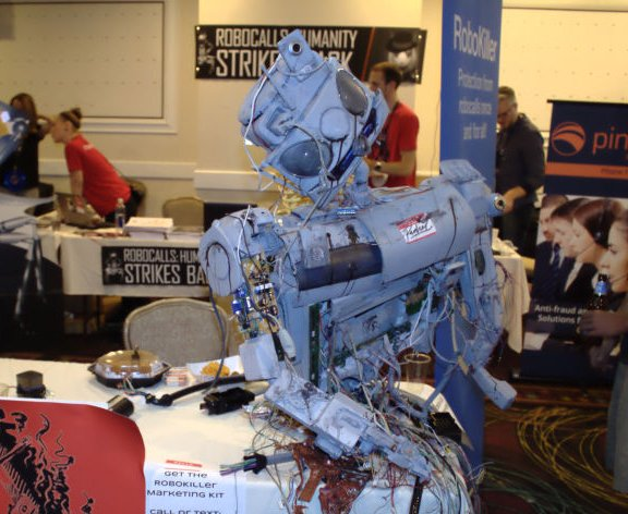 Rachel the Robot, deceased, at RoboKiller's table in the FTC robocall challenge area at DEF CON 23.