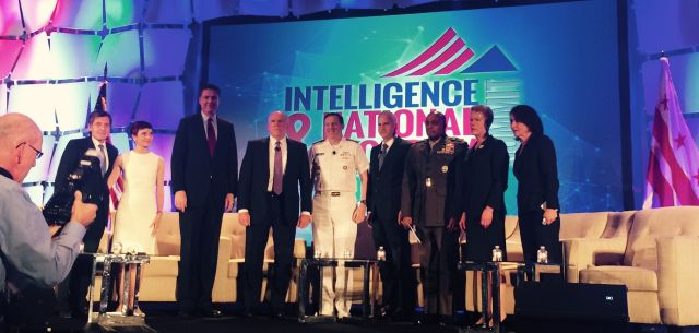 The directors of the FBI, CIA, NSA, NGO, DIA, and NRO stand for a group picture with Fox News' Catherine Herridge (second from left) and executives of INSA and AFCEA at the conclusion of their panel discussion at the Intelligence & National Security Summit in Washington on September 10.