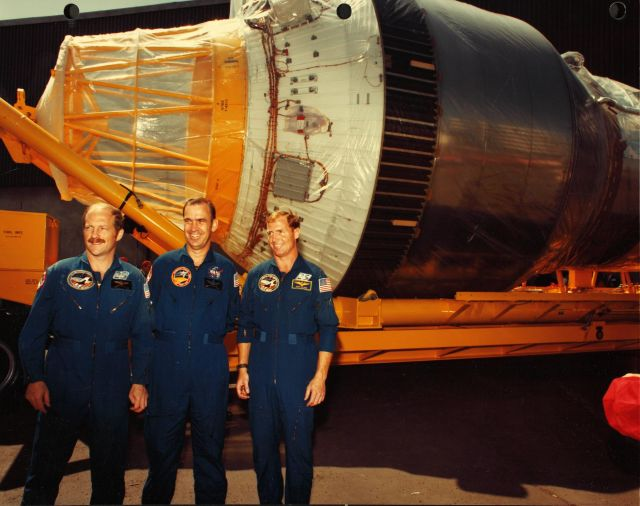 Astronauts Rick Hauck, John Fabian, and Dave Walker pose by a Shuttle-Centaur stage in mid-1985 during a rollout ceremony. Hauck and Fabian both had misgivings about Shuttle-Centaur.