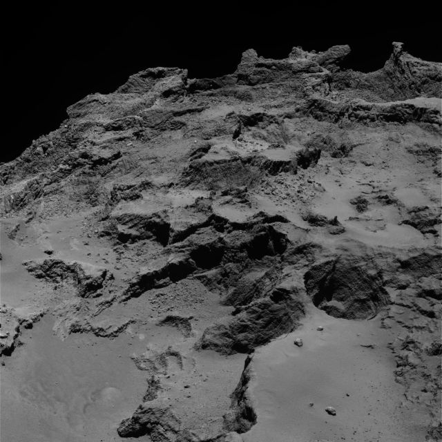 Take a look at both the bright plateaus in the middle of this image and the steps cutting into a ledge near the bottom. These are part of a coherent system of features that extend into the comet's interior.