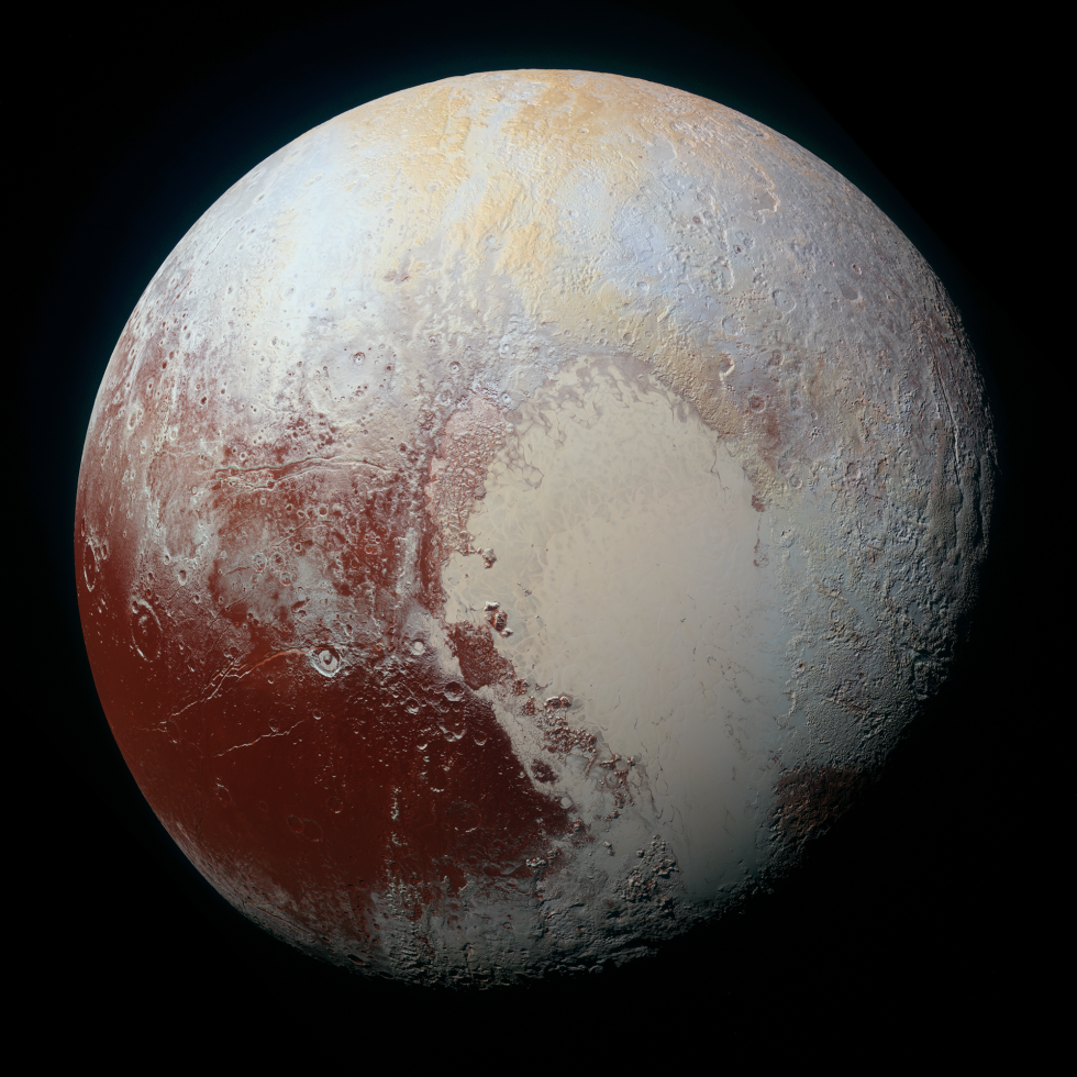A red/blue/infrared image of the dwarf planet reveals that many of the features we'd seen in earlier images have their own distinctive colors.